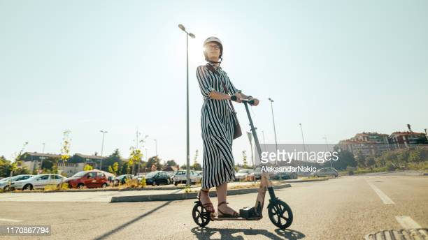 commuting on an electric scooter - electric scooter stock pictures, royalty-free photos & images