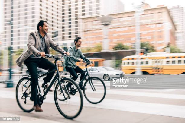 commuting with work partner by bicycle - riding stock pictures, royalty-free photos & images