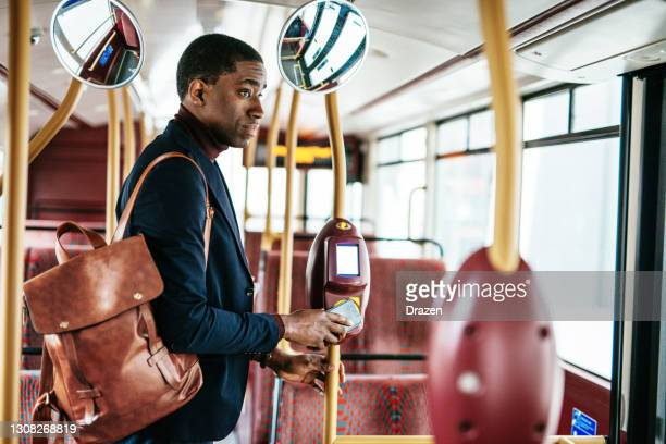 commuting without face mask during coronavirus pandemic - bus stock pictures, royalty-free photos & images