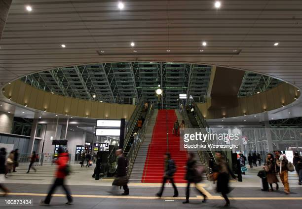 Commutors walk at Osaka Station on February 6 2013 in Osaka Japan A recent servey shows Tokyo as the most expensive city in the world and Osaka...