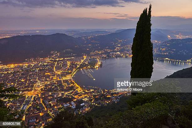 como city and como lake at sunset - lombardy stock pictures, royalty-free photos & images
