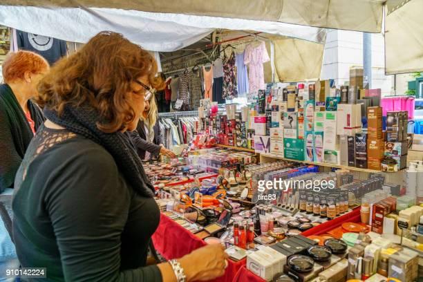 como street market. people pictured at a cosmetics stall - bancarella foto e immagini stock