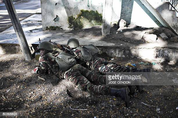 Comoran army take positions during fightings against Anjouanese gendarmes in Ouani near Mutsamudu on March 25 2008 African Union and Comoran troops...