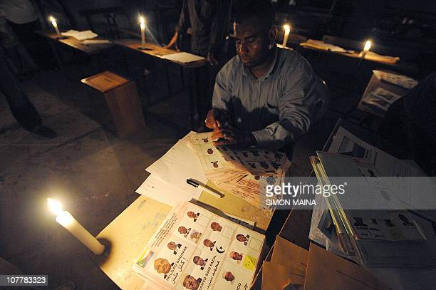A Comoran electoral agent counts ballots on December 26 2010 in Moroni after the Indian Ocean archipelago voted today for a new president to replace...