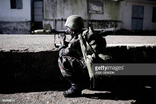 A Comoran soldier take positions during fightings against Anjouanese gendarmes in Ouani near Mutsamudu on March 25 2008 African Union and Comoran...