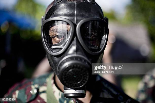 A Comoran soldier wears a gas mask during a military training 17 March 2008 in Fomboni the capital of Moheli The Comoran army conducted two...