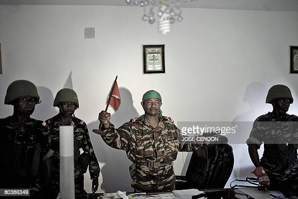 Comoran soldiers pose in the office of Anjouan renegade leader Mohamed Bacar at the presidential palace in Ouani near Mutsamudu on March 26 2008...