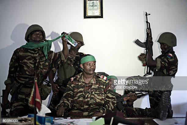 Comoran soldiers pose on the desk of Anjouan renegade leader Mohamed Bacar at the presidential palace in Ouani near Mutsamudu on March 26 2008...