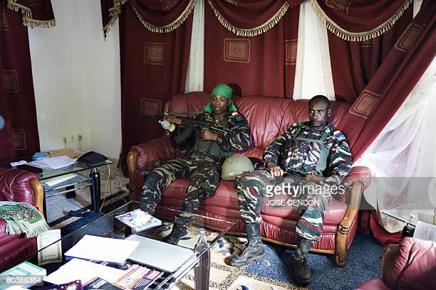 Comoran soldiers sit in the office of Anjouan renegade leader Mohamed Bacar at the presidential palace in Ouani near Mutsamudu on March 26 2008...