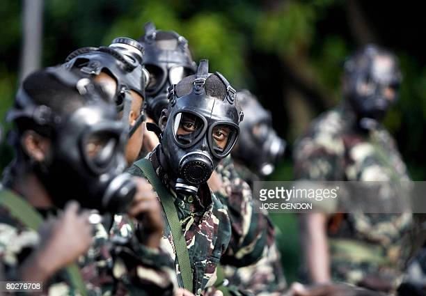 Comoran soldiers wear gas masks during a military training on March 17 2008 in Fomboni the capital of Moheli The Comoran army conducted two...