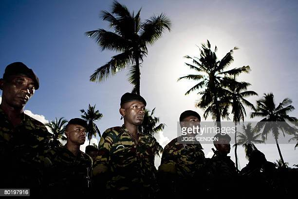 Comoran troops attend a ceremony with Comoran Minister of Defense Mohamed Bacar Dossar on March 11 2008 in Fomboni to prepare for the recapture the...