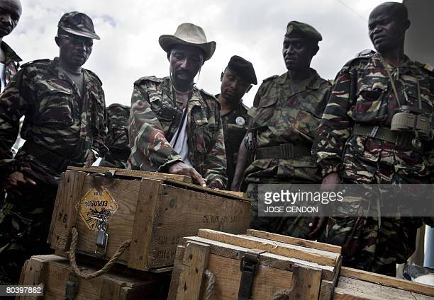 Comoran troops display for the press boxes of ammunition which were supposedly sent by France to renegade Anjouan leader Mohamed Bacar in Mutsamudu...