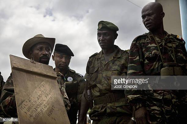 Comoran troops show to the press boxes of ammunition which were allegedly sent by France to renegade Anjouan leader Mohamed Bacar in Mutsamudu the...