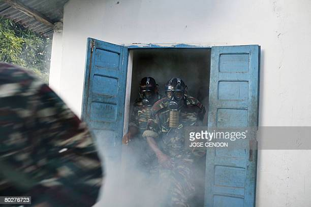 Comoran troops take part in military training exercises on March 2008 in Fomboni to prepare for the recapture of the nearby rebel island of...