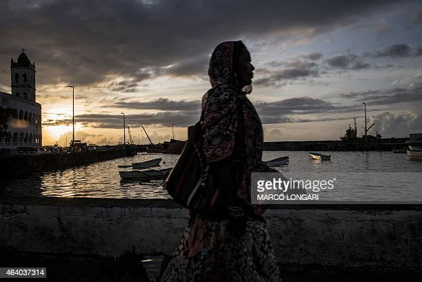 A Comoran woman walks along the waterfront in Moroni on February 21 2015 on the eve of the second round of the legislative elections The second phase...