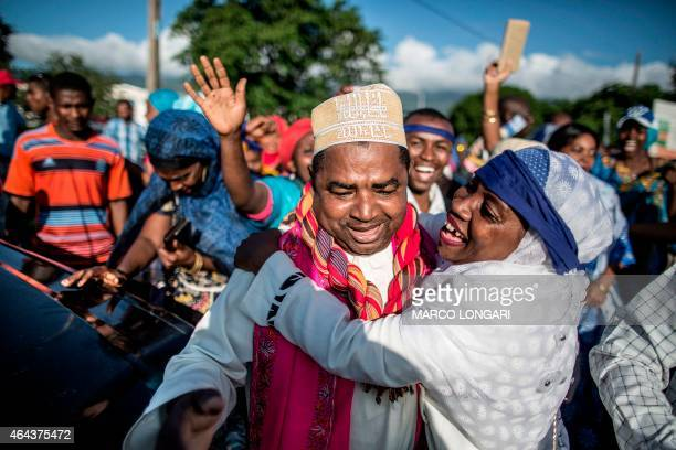 Comorans greet on February 25 2015 a candidate who won a parliamentary seat outside the Island Parliament in Moroni following results of the second...