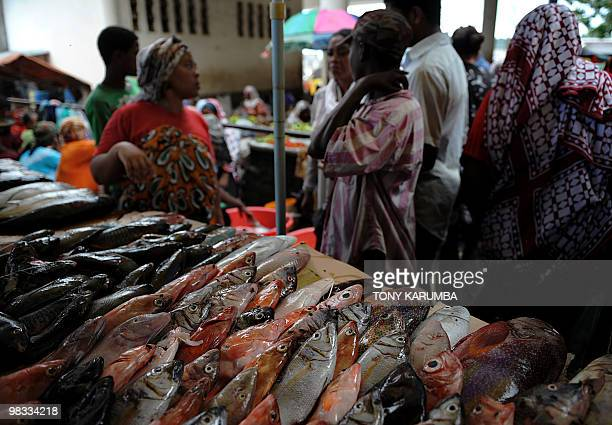 Comoran's sell and buy fish at a local market within Moroni April 7 2010 The Indian Ocean archipelago of Comoros faces political instability after...