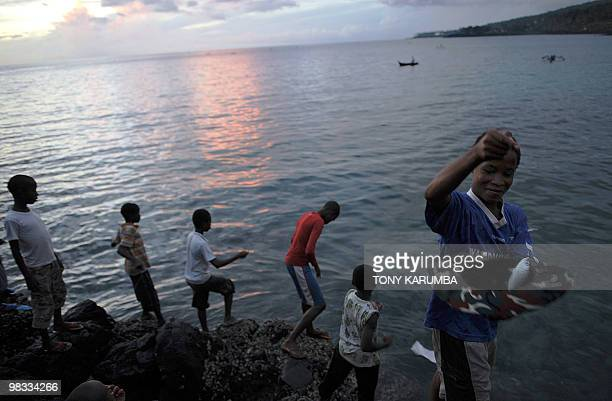 Comoran's sell and buy fish at a local market within Moroni on April 7 2010 The Indian Ocean archipelago of Comoros faces political instability after...