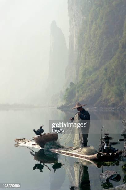 Comorant Birds Sitting on Fisherman's Boat in Li River