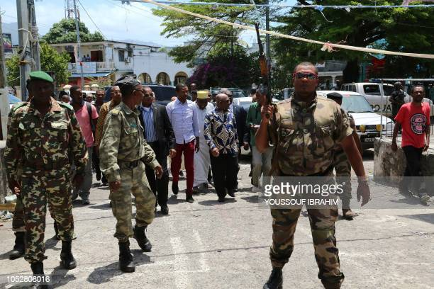 Comorian President Azali Assoumani arrives to take a walk through the Medina of Mutsamudu on October 23 2018 in Anjouan Comoros Officials in Comoros...