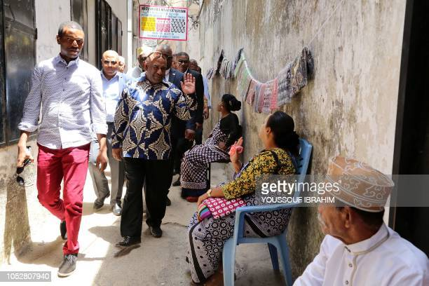 Comorian President Azali Assoumani greets residents as he walks through the Medina of Mutsamudu on October 23 2018 in Anjouan Comoros Officials in...