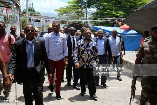 Comorian President Azali Assoumani takes a walk through the Medina of Mutsamudu on October 23 2018 in Anjouan Comoros Officials in Comoros displayed...