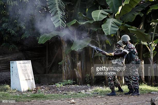 A Comorian soldier shoots at the positions of supporters of renegade Anjouan leader Mohamed Bacar in Mutsamudu the Anjouan capital on 25 March 2008 A...