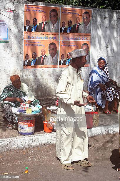 Comorian street sellers stand in front of posters portraying presidential candidates on October 15 2010 in a street of the Island of Moroni Last...