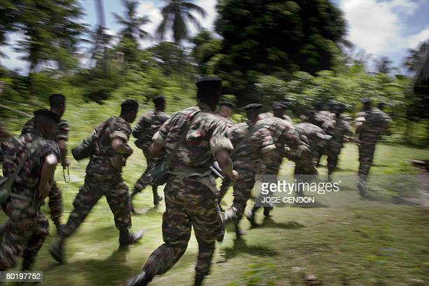 Comorian troops take part in military training exercises on 11 March 2008 in Fomboni to prepare for the recapture the rebel island of Anjouan Sudan...