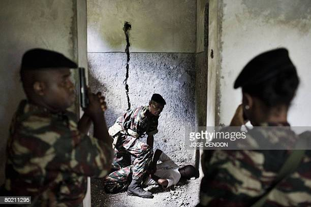 Comorian troops take part in military training exercises on 11 March 2008 in Fomboni to prepare for the recapture the nearby rebel island of Anjouan...