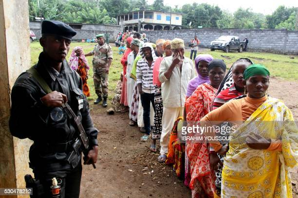 Comorians from Mrijou queue to cast their ballot in a re run of the presidential elections on May 11 2016 in Mrijou on Anjouan Island Comoros Several...