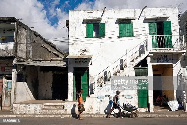Comoros Anjouan Mutsamudu man with wheelbarrow of tuna