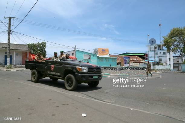Comoros Armed forces members drive by the entrance of the Medina in Mutsamudu on the island of Anjouan Comoros on October 19 2018 Comoros security...