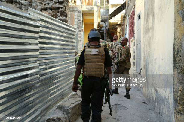 Comoros Armed forces members search and patrol the Medina for weapons and armed men at Mutsamudu on October 20 2018 on the island of Anjouan The...