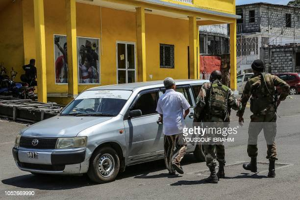 Comoros army soldiers check a car at a checkpoint in Mutsamudu on October 21 2018 The Comoros military on October 20 regained control of Mutsamudu's...