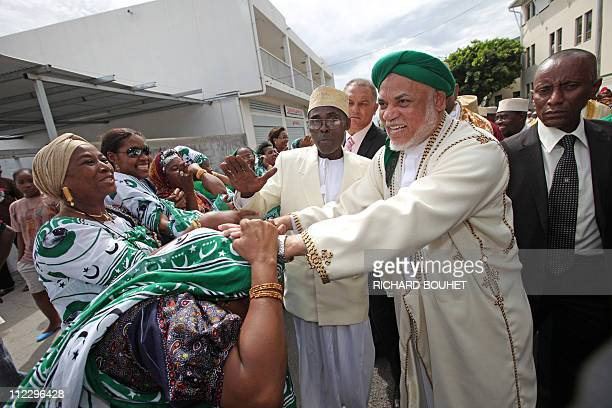 Comoros' President Ahmed Abdallah Mohamed Sambi is welcomed by people upon his arrival on April 17 2011 at Le Port for a threeday visit in the French...