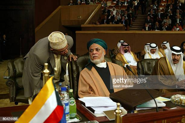 Comoros President Ahmed Abdallah Sambi listens to a delegate at the opening of the Arab Summit on March 29 2008 in Damascus Syria The Arab summit...