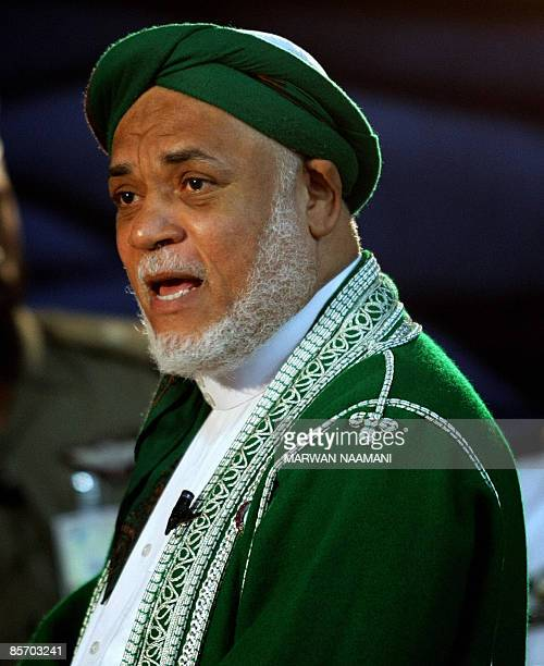 Comoros President Ahmed Abdullah Sambi speaks to press on the sidelines of the Arab League summit in Doha on March 30 2009 Sambi urged fellow Arab...