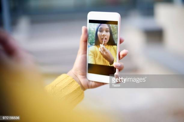 compact, connected and so convenient, i love my device - mirror selfie stock pictures, royalty-free photos & images