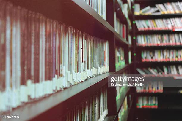 compact discs arranged on shelf in library - compact disc stock pictures, royalty-free photos & images