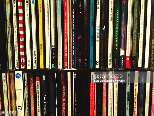compact discs in shelf - compact disc stock pictures, royalty-free photos & images