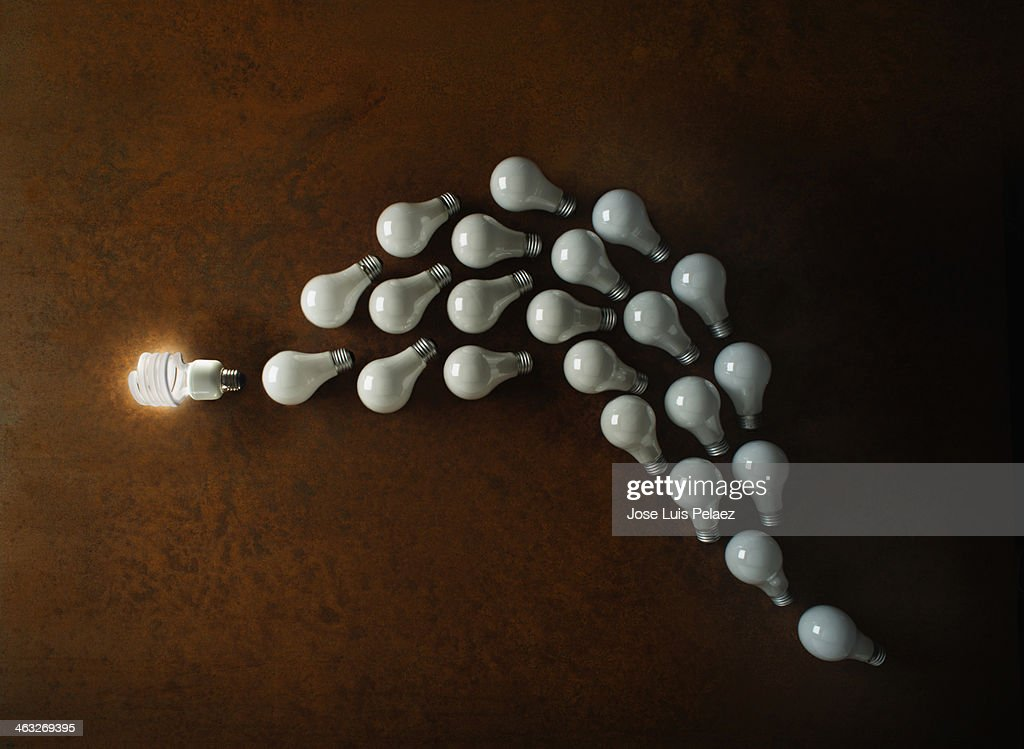 Compact Fluorescent Lightbulb leading the pack : Stock Photo