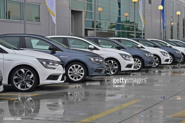 compact vehicles on the parking - renault stock pictures, royalty-free photos & images
