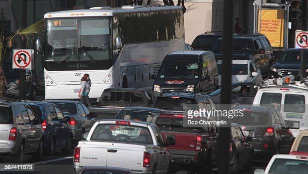 Companies like Google are using private buses like this one in traffic on Cesar Chavez Street to ferry their employees from the downtown San...