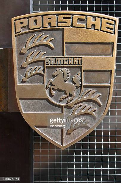 A company badge is seen on an entrance door to the Porsche AG plant in Stuttgart Germany on June 22 2012 Porsche AG which is jointly owned by...
