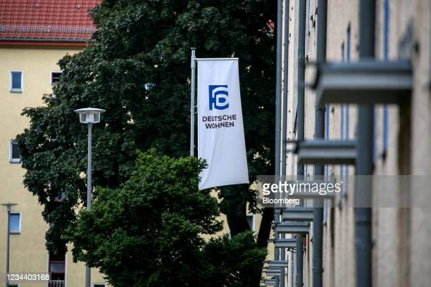 Company banner outside residential apartment blocks on the Carl Legien modernist housing estate, operated by Deutsche Wohnen SE, in Berlin, Germany,...