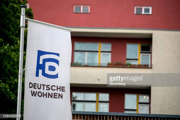 Company banner outside residential apartments on the Carl Legien modernist housing estate, operated by Deutsche Wohnen SE, in Berlin, Germany, on...