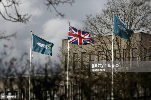 A company branded flag flies next to the Union Flag also known as the Union Jack outside GKN Plc's company headquarters in Redditch UK on Tuesday...