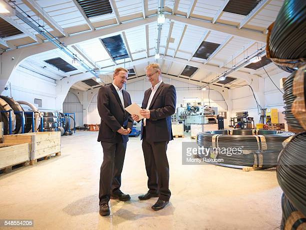 Company directors with digital tablet in automotive parts factory