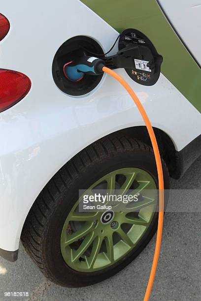 A company electric Smart car of German engineering company Siemens at the behest of the photographer stands attached via a charging cable from a...